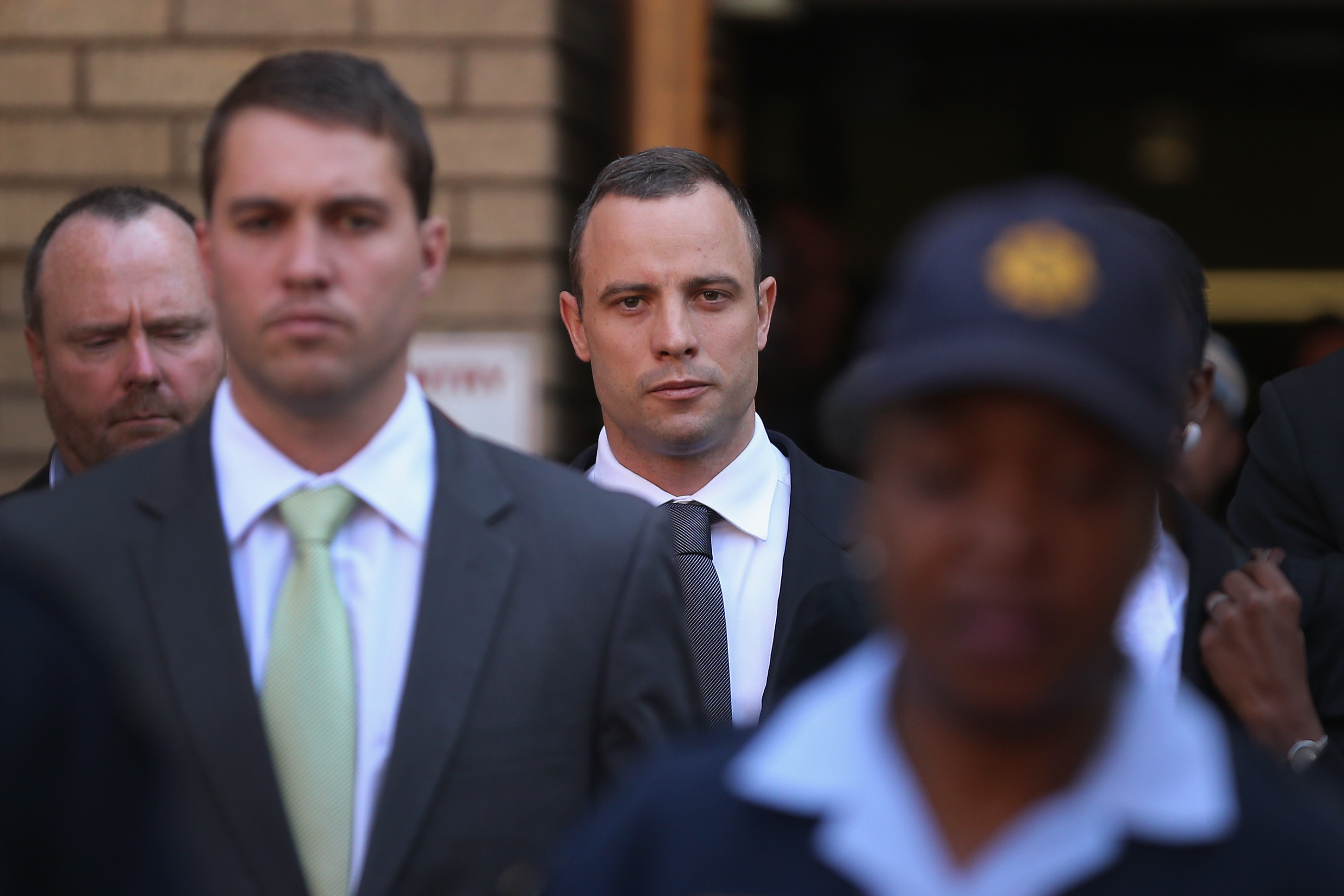 Oscar Pistorius leaves North Gauteng High Court after the judge ordered tht he should undergo mental evaluation on May 14, 2014 in Pretoria, South Africa.