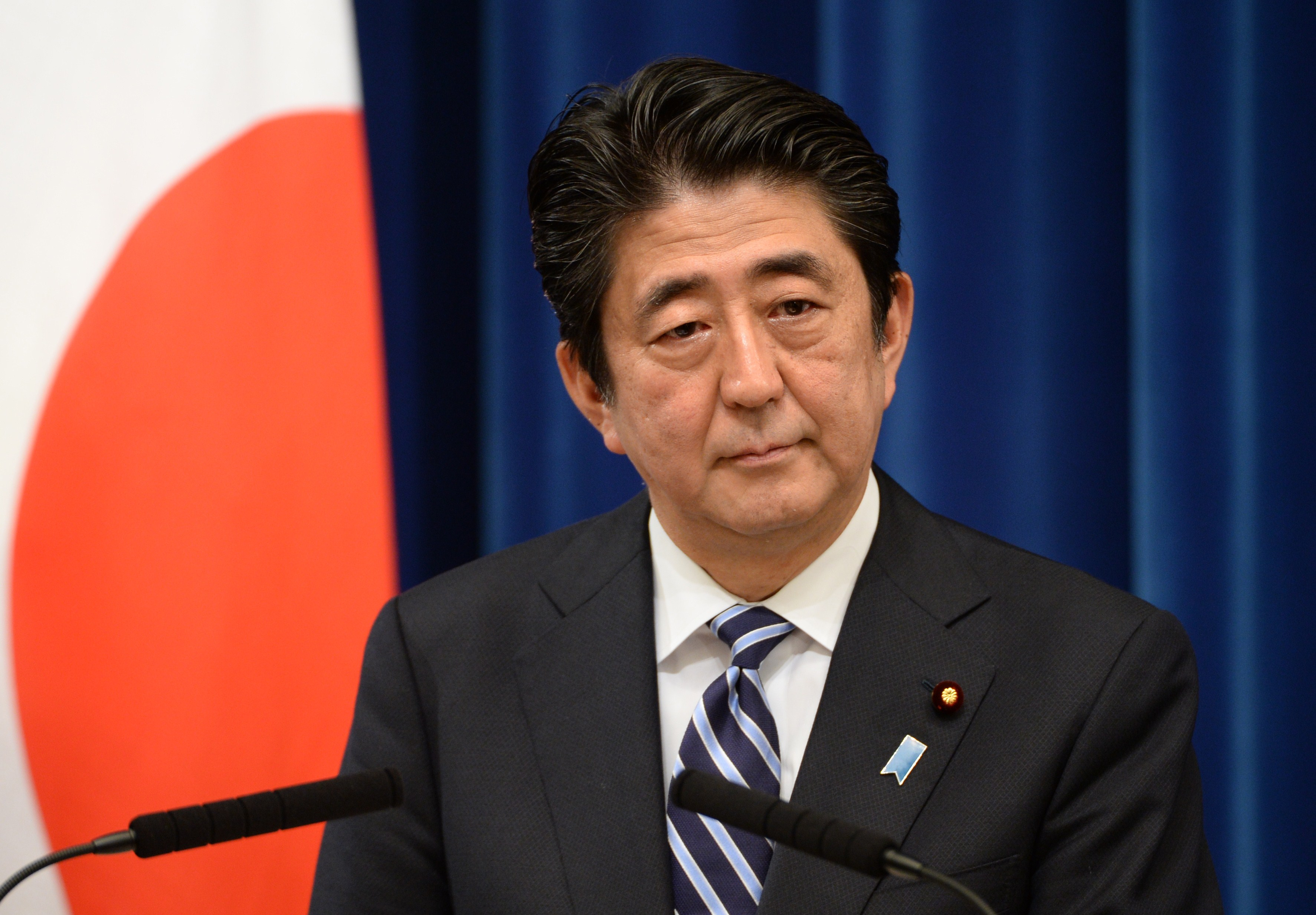 Japan's Prime Minister Shinzo Abe delivers a speech during a press conference at his official residence in Tokyo on May 15, 2014