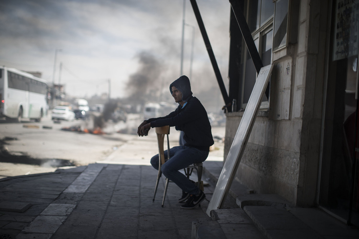 May 15, 2014. Palestinian seen sitting  during clashes with the Israeli army during Nakba day near the Qalandia checkpoint at the outskirts of Ramallah, the West Bank.