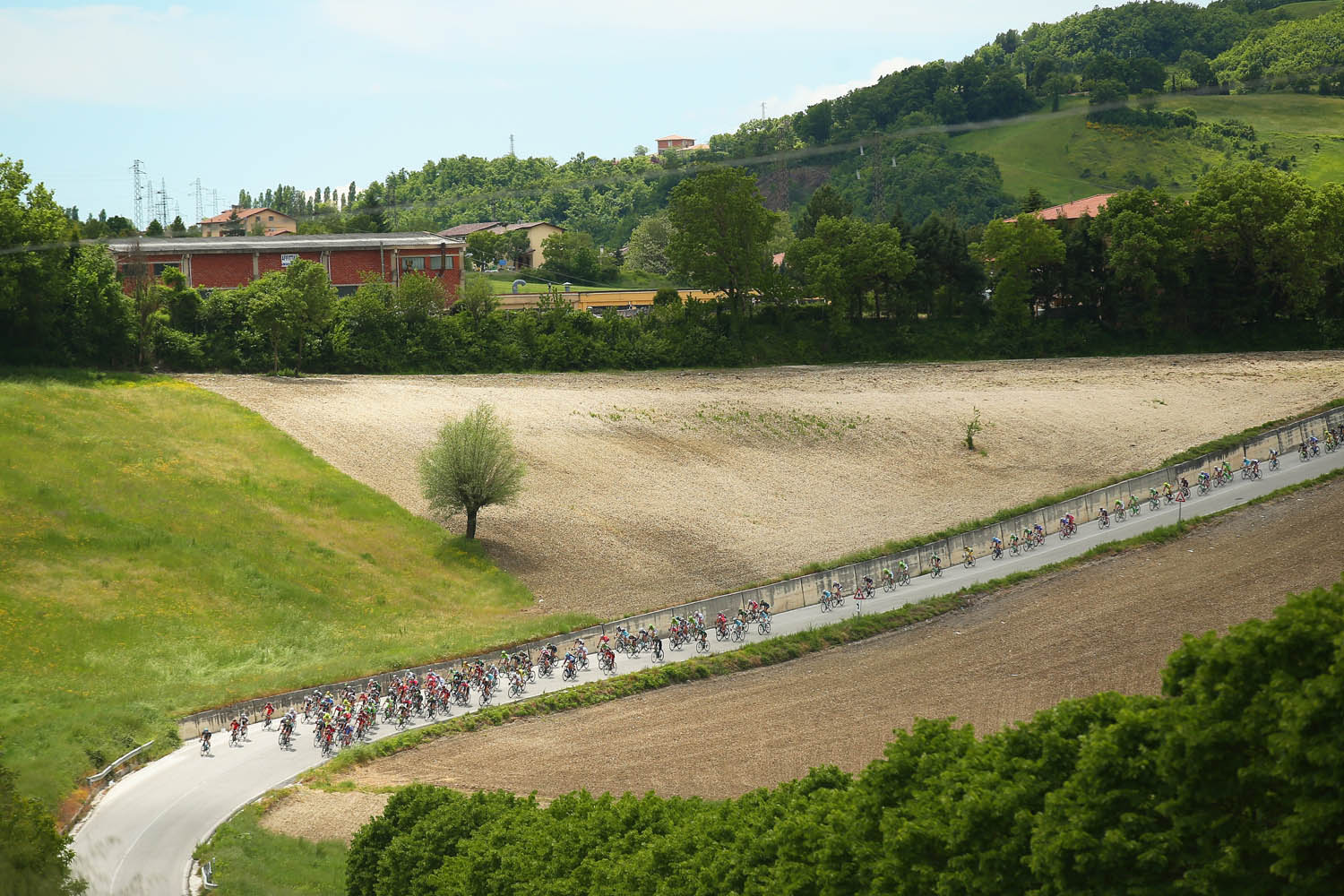May 17, 2014. The peloton in action during the eighth stage of the 2014 Giro d'Italia, a 179km medium mountain stage between Foligno and Montecopiolo in Folignano, Italy.