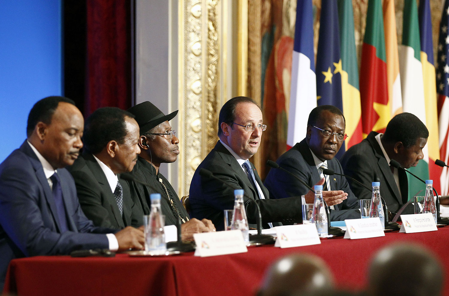 From left: Niger's President Mahamadou Issoufou, Cameroon's President Paul Biya, Nigeria's President Goodluck Jonathan, French President François Hollande, Chad's President Idriss Déby and Benin's President Thomas Boni Yayi attend a  joint press conference at the Élysée Palace in Paris on May 17, 2014