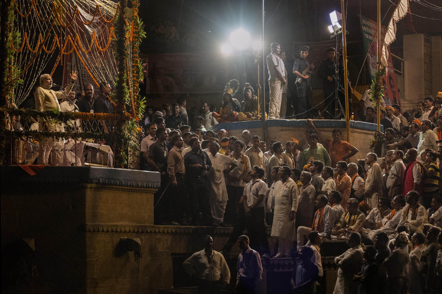 May 17, 2014. BJP leader Narendra Modi (top left) speaks to supporters after performing the Hindu Ganga Puja prayer ritual at the Dashaswamadeh Ghat on the Holy River Ganges the day after his election victory in Varanasi, India.