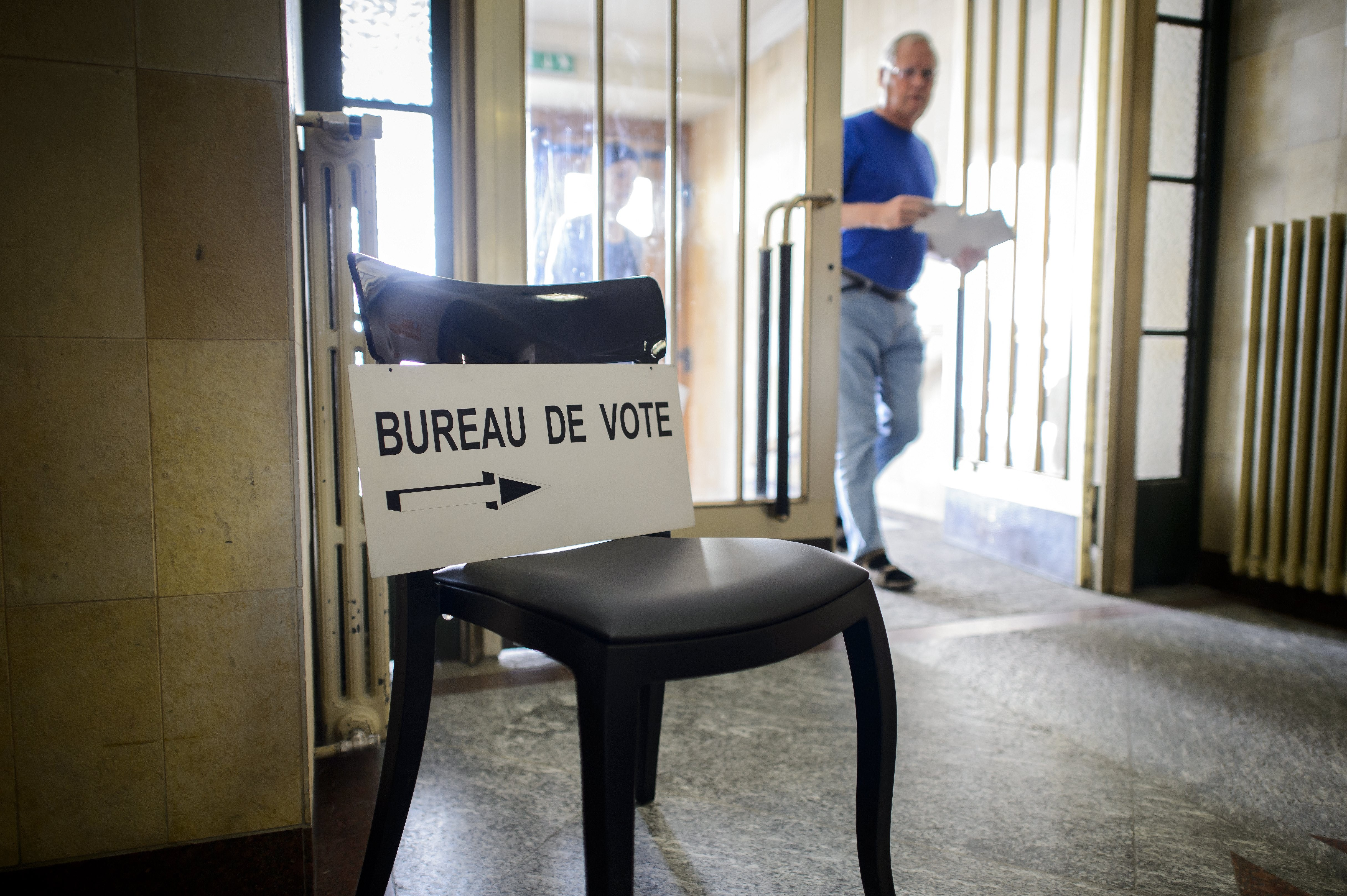 A man arrives to casts his ballot during a referendum on May 18, 2014 in Bulle, western Switzerland.