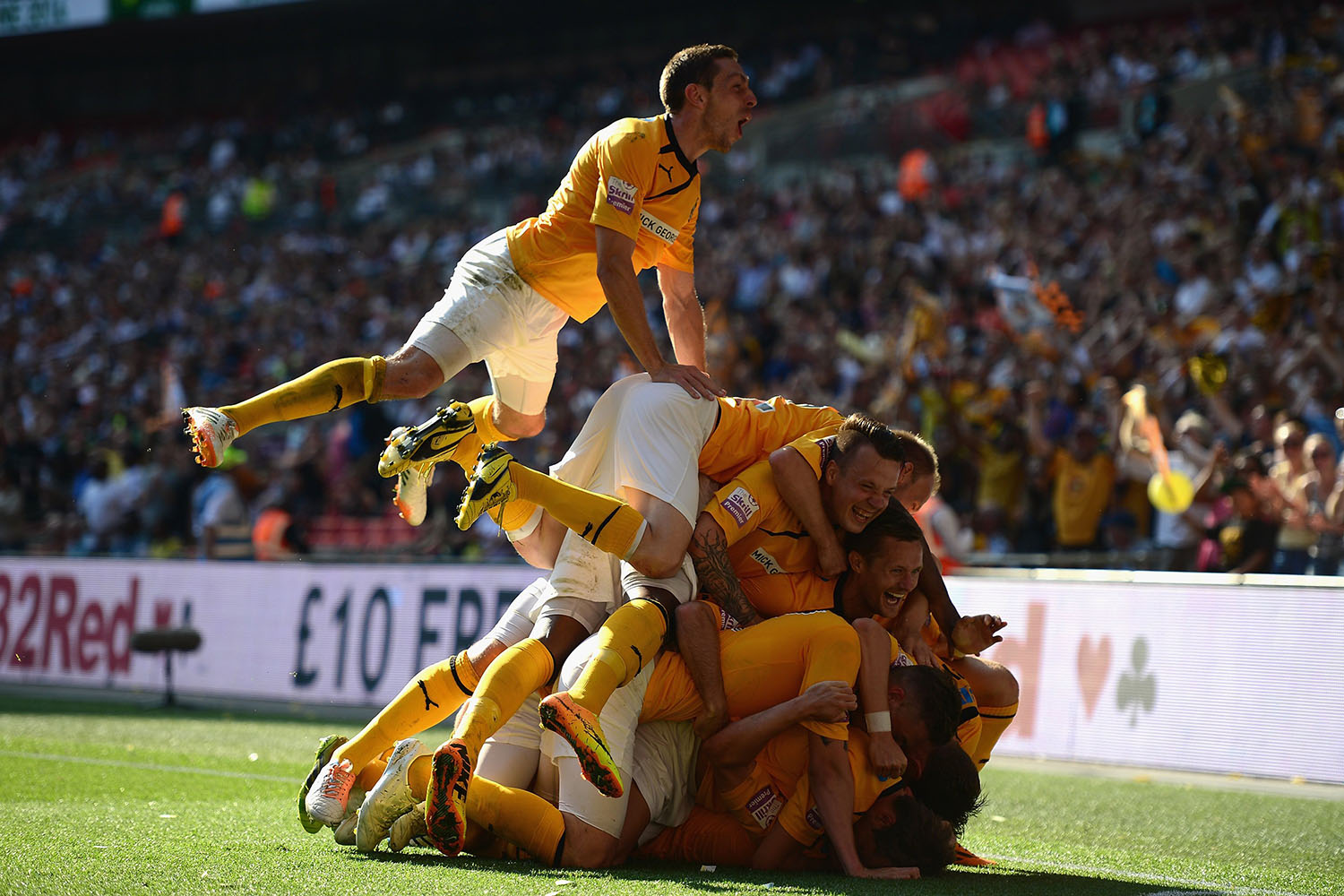 Ryan Donaldson of Cambridge United celebrates his goal with team mates during the Skrill Conference Premier Play-Offs Final between Cambridge United and Gateshead FC at Wembley Stadium in London, on May 18, 2014.