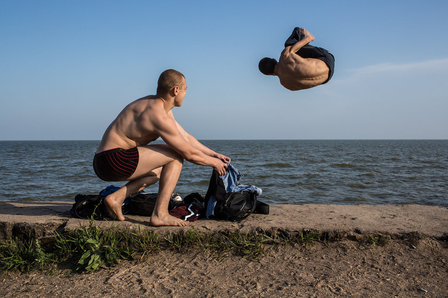 Men practice parkour on the beach in Mariupol, Ukraine, on May 18, 2014.