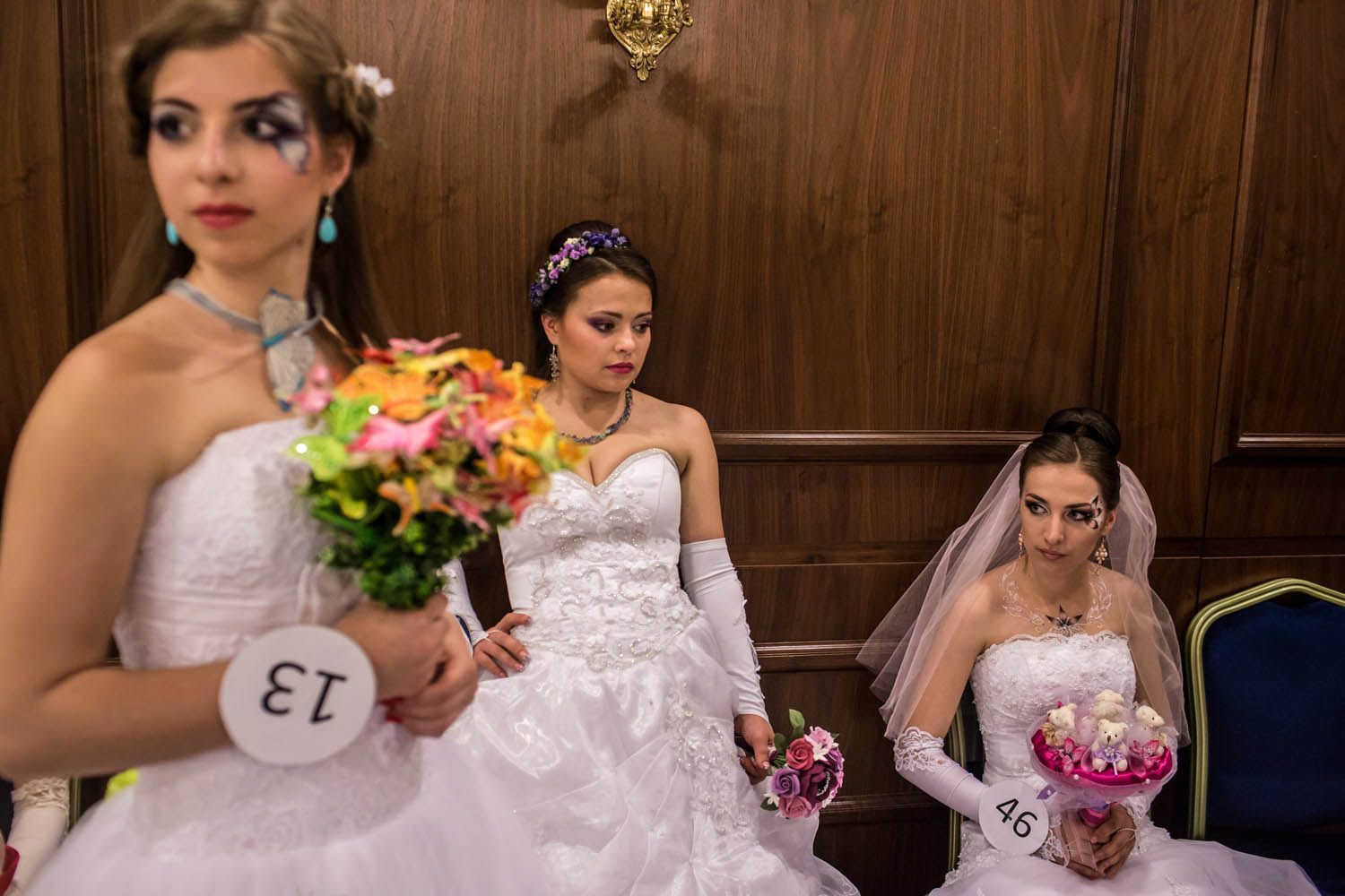 May 18, 2014. Contestants at a bridal contest wait backstage in Donetsk, Ukraine. A week before presidential elections are scheduled, questions remain whether the eastern regions of Donetsk and Luhansk are stable enough to administer the vote.