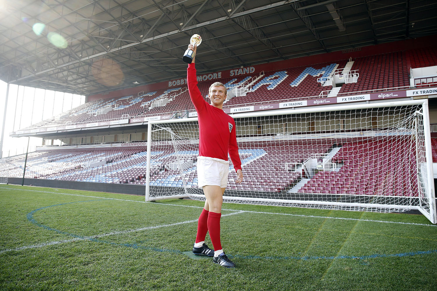 Madame Tussauds unveils a new wax figure of 1966 England Captain, Bobby Moore at West Ham United's Boelyn Ground in London, on May 19, 2014.