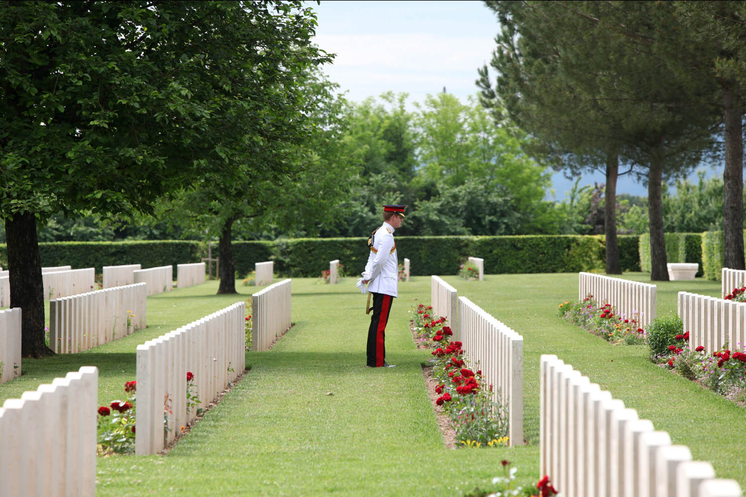 May 19, 2014. Prince Harry walks between graves at the Commonwealth War Graves Commission Cassino War Cemetery and Memorial on  in Cassino, Italy.
