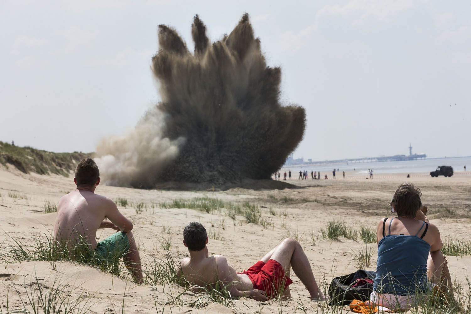 May 19, 2014. Beach goers watch the detonation of a 500 pound British bomb on the beach in Wassenaar, Netherlands. The bomb was dropped by the British allied forces during the second world war over nearby Leiden where it was found on a building site.