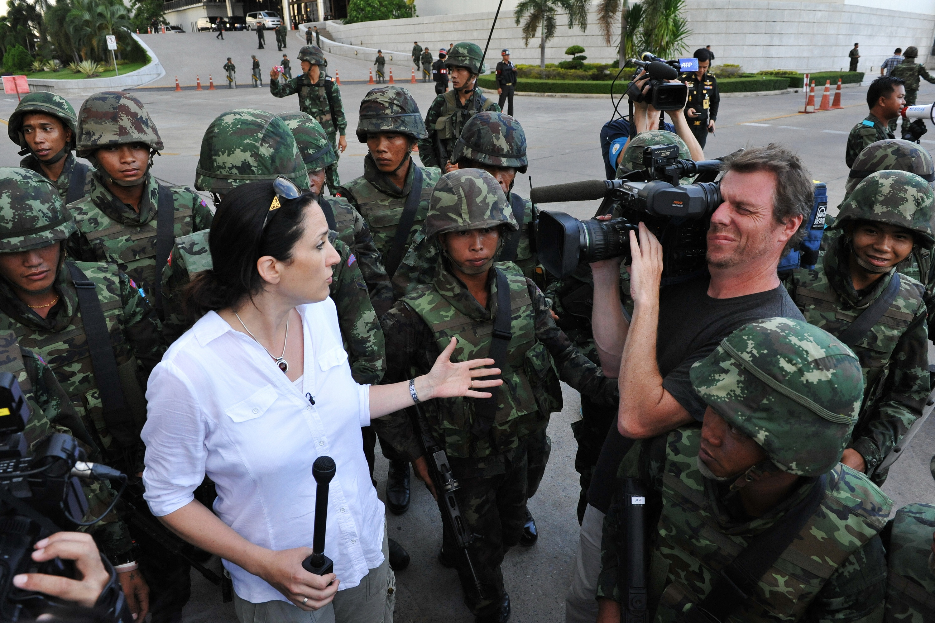 Thai soldiers move foreign press on as they secure the grounds of the venue for peace talks between pro- and antigovernment groups as the army announces it is seizing power in Bangkok on May 22, 2014
