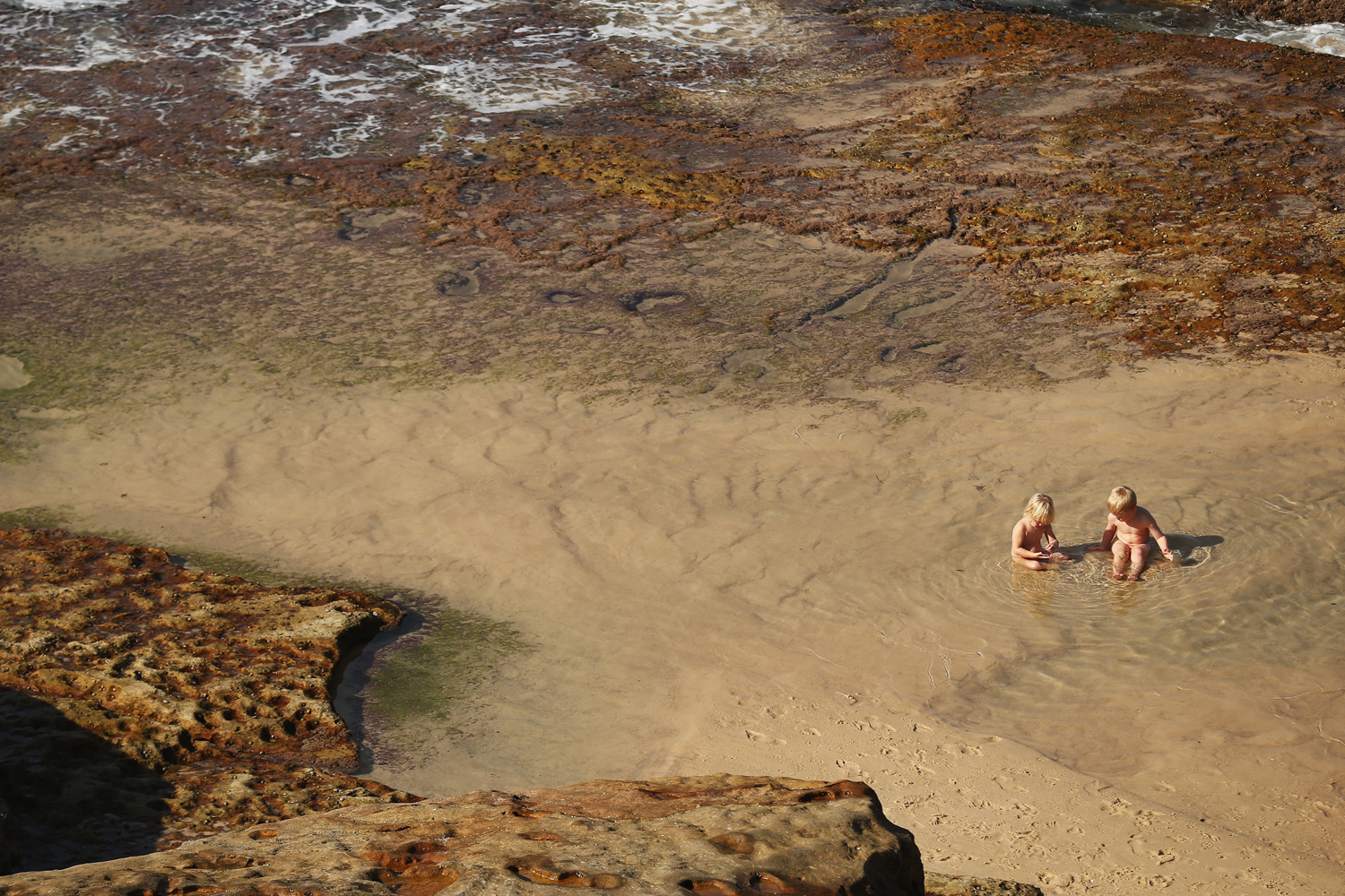 May 23, 2014. Children play in a pond on  in Sydney, Australia. Sydney is experiencing it's hottest May on record, already recording it's hottest week for this time of year in over 150 years.