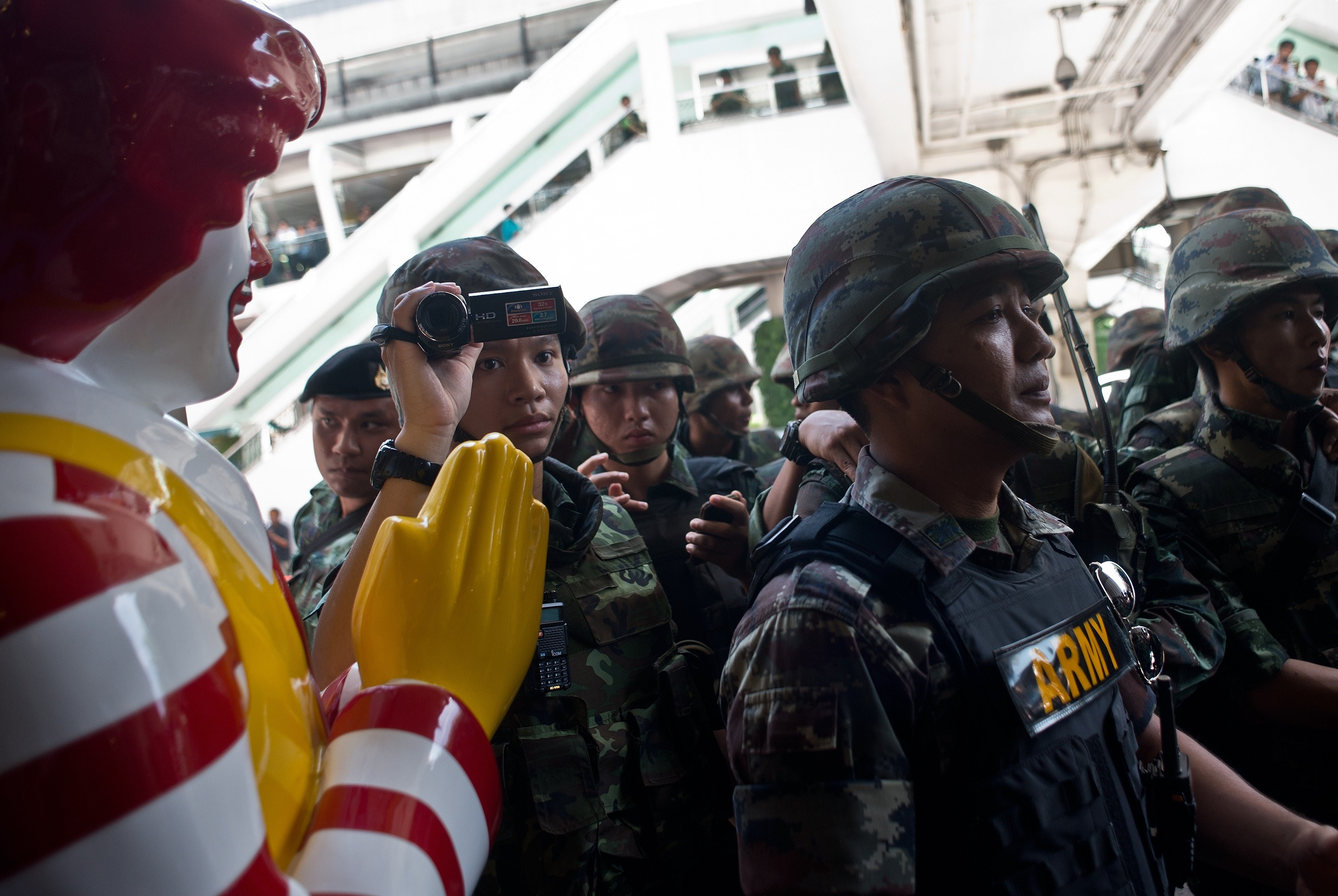 Thai-army soldiers stand guard outside a McDonalds outlet ahead of a planned gathering in Bangkok on May 25, 2014.