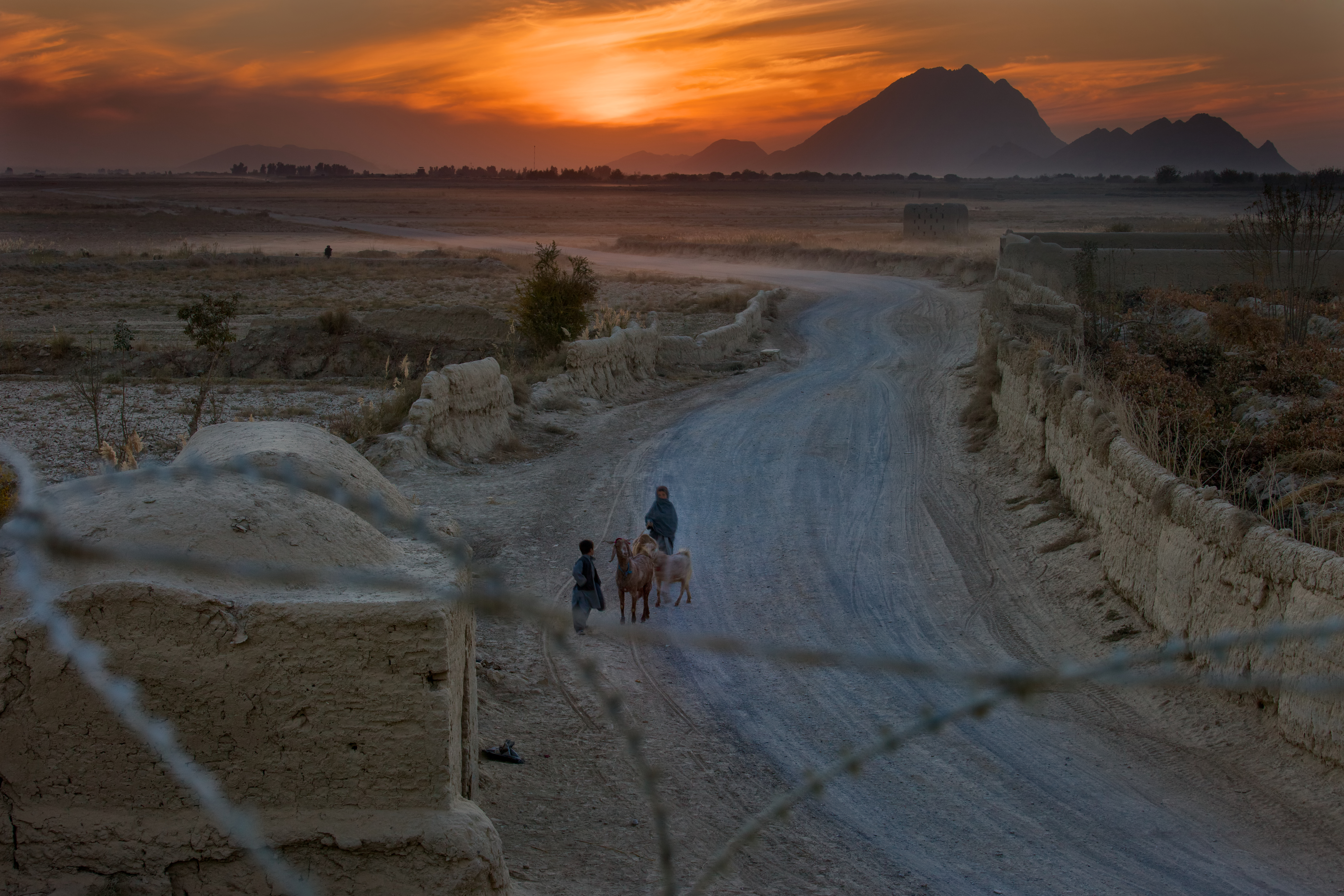Afghan youngsters head home near Kandahar, just as U.S. troops will be doing.