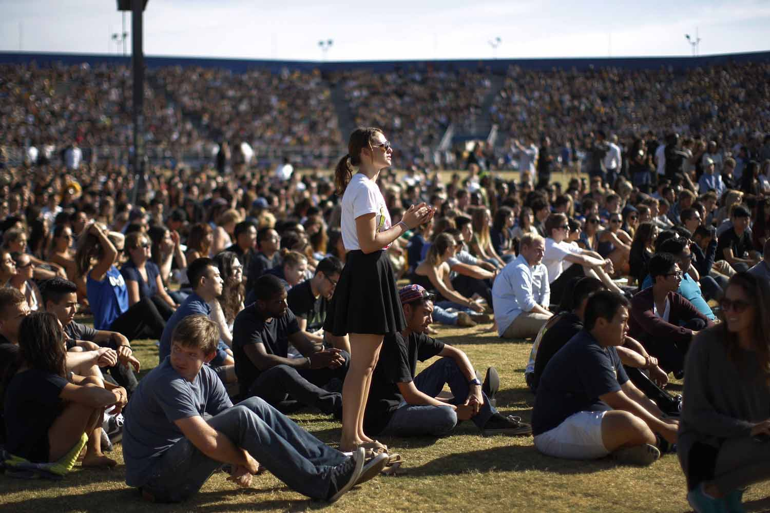 May 27, 2014. Students mourn at a public memorial service on the Day of Mourning and Reflection for the victims of a killing spree at University of California, Santa Barbara  in Isla Vista, California.