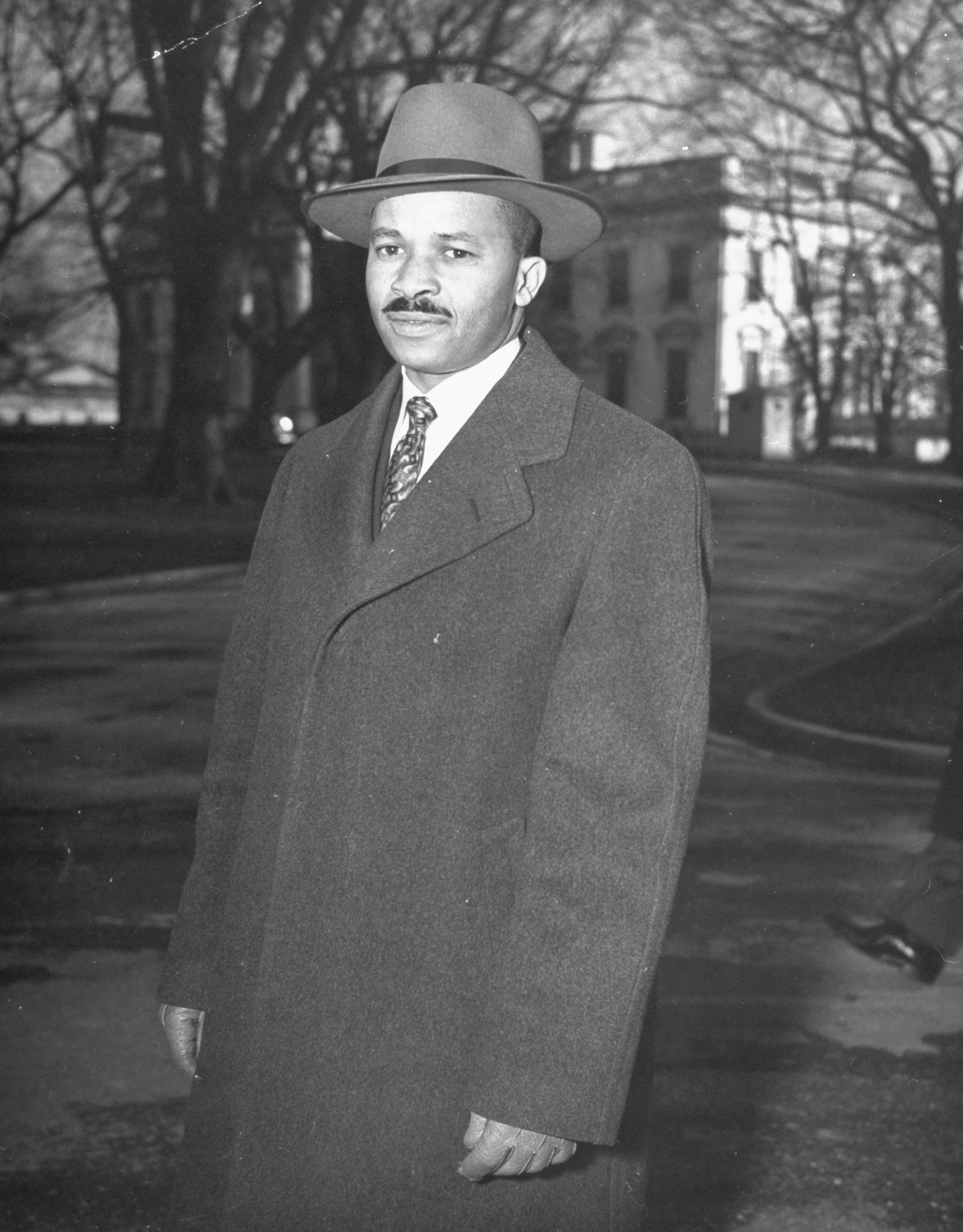 Reporter Harry McAlpin leaving the White House after a press conference in 1944.