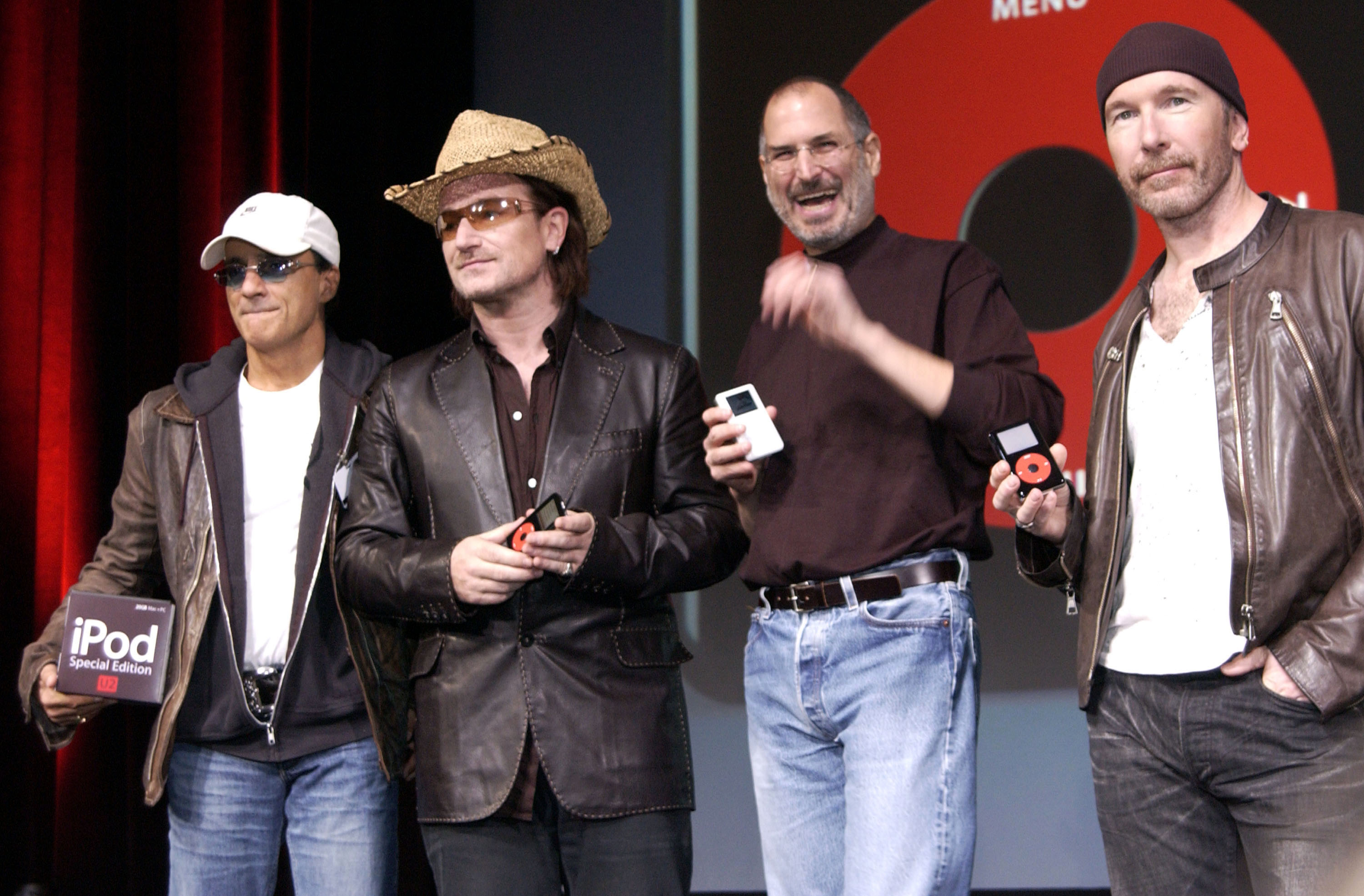 Steve Jobs (2nd-R) of Apple Computer poses with Interscope Geffen A&M Records Chairman Jimmy Iovine (L) Bono (2nd-L) and The Edge (R) of U2 at a celebration of the release of a new Apple iPod family of products at the California Theatre on Oct. 26, 2004 in San Jose, Calif.