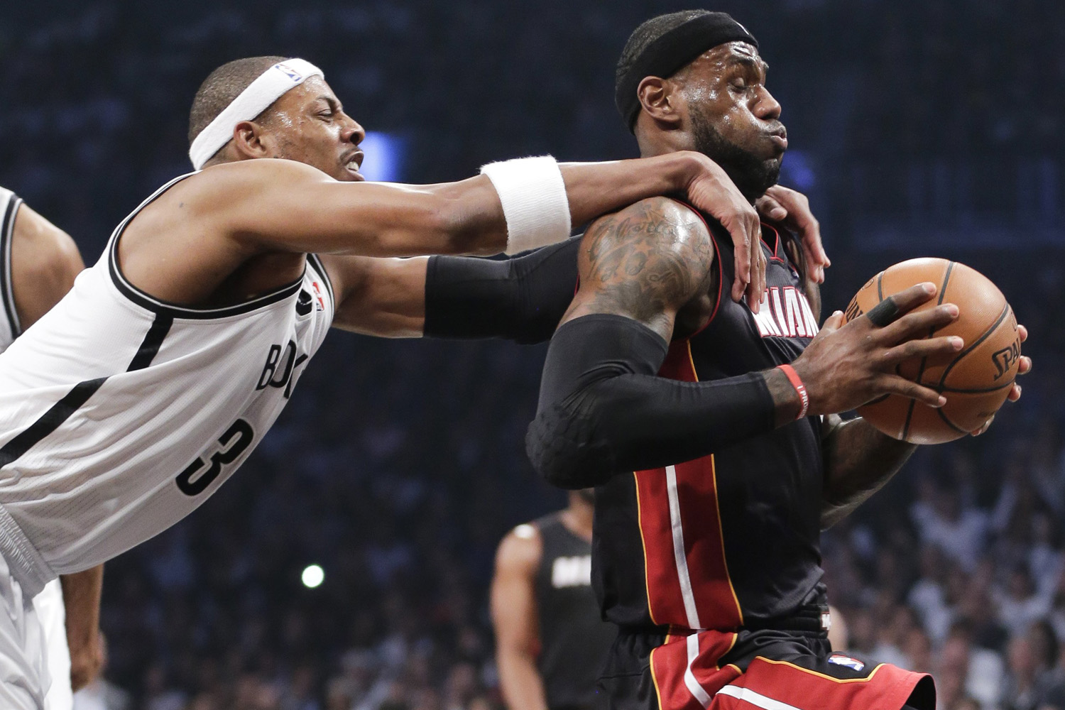 May 10, 2014. Brooklyn Nets forward Paul Pierce (34) fouls Miami Heat forward LeBron James (6) as he drives through the lane to score in the first period during Game 3 of an Eastern Conference semifinal NBA playoff basketball game.