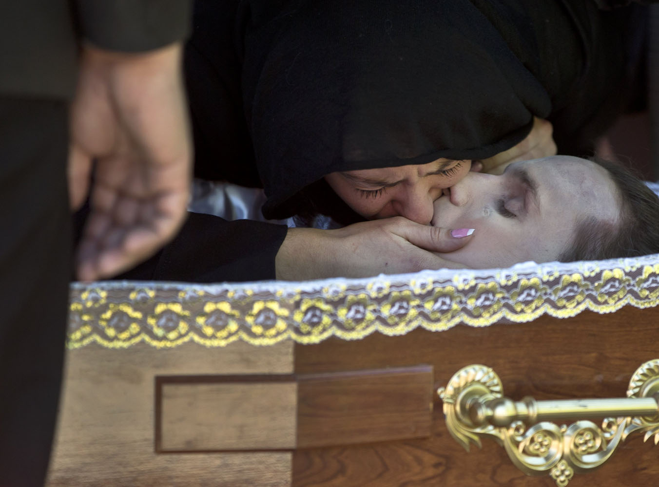 May 7, 2014. The girlfriend of Andrei Brazhevskiy, a pro-Russian activist, kisses him before the coffin is closed during the funeral in Odessa, Ukraine, Brazhevskiy, 27, died after jumping out of the burning trade union building in an attempt to escape Friday's fire that killed most of the 40 people that died after riots erupted.