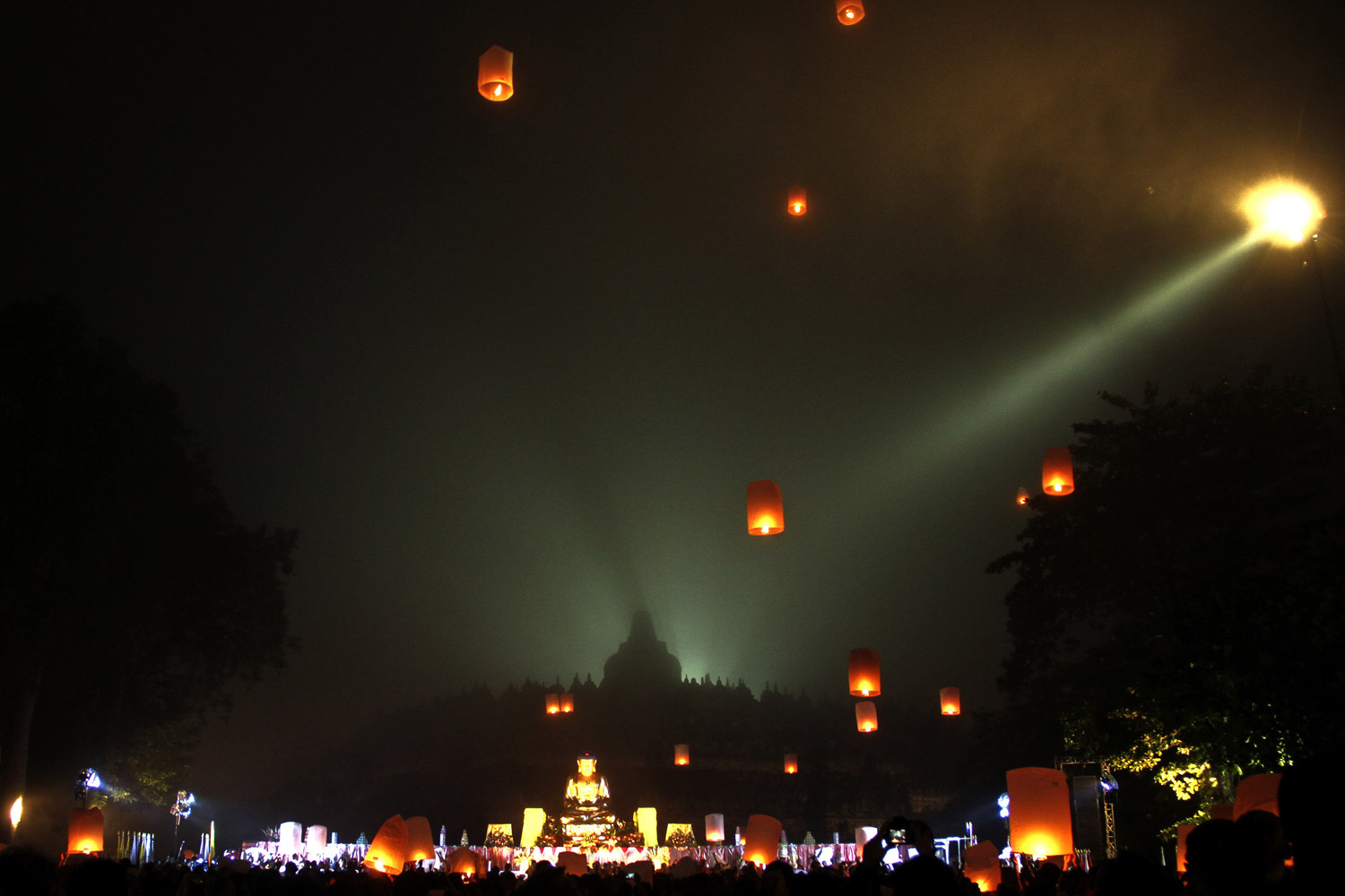 May 15, 2014. Buddhists fly lanterns during a celebration of Vesak day, which marks the birth, enlightenment, and death of Buddha, at Borobudur temple in Magelang, Central Java, Indonesia,