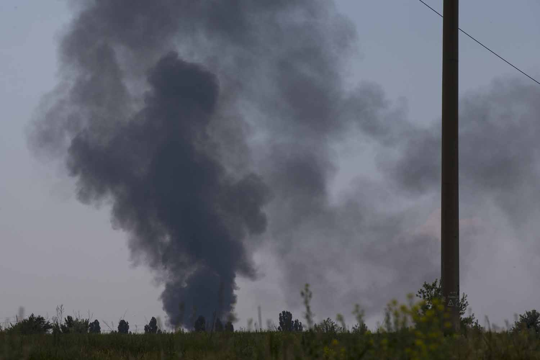 May 29, 2014. Black smoke rises from a shot down Ukrainian Army helicopter outside Slovyansk, Ukraine.