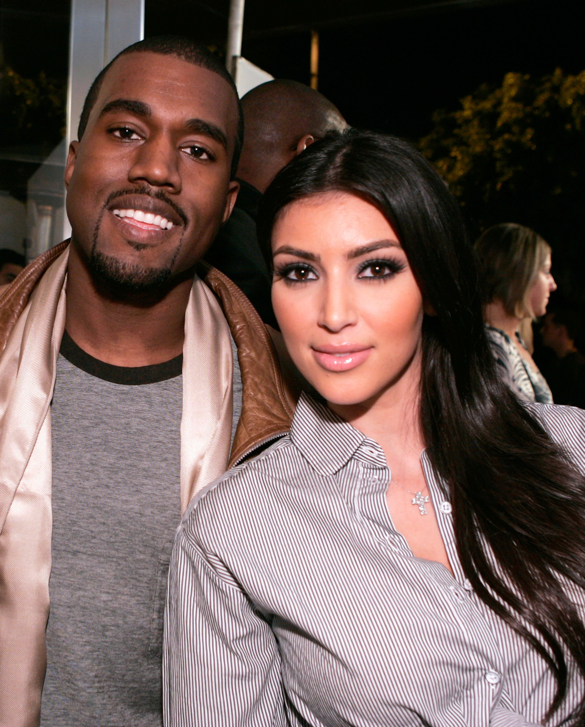 "Ah, Sept. 25, 2007: Even though Kimye's friendship began in 2004, this was the very first time the two posed together in public. Sure they were ""just friends""—Kanye was at the store Intermix's grand opening with his former fiancé and Kim was dating Reggie Bush— but pictures don't lie. That is one couple begging for a lifetime of being photographed next to each other."