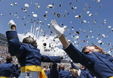 Air Force Academy graduates throw their caps into the air as F-16 jets from the Air Force group, The Thunderbirds, make a flyover at the completion of the graduation ceremony for the class of 2014 at the U.S. Air Force Academy in Colorado on May 28, 2014.