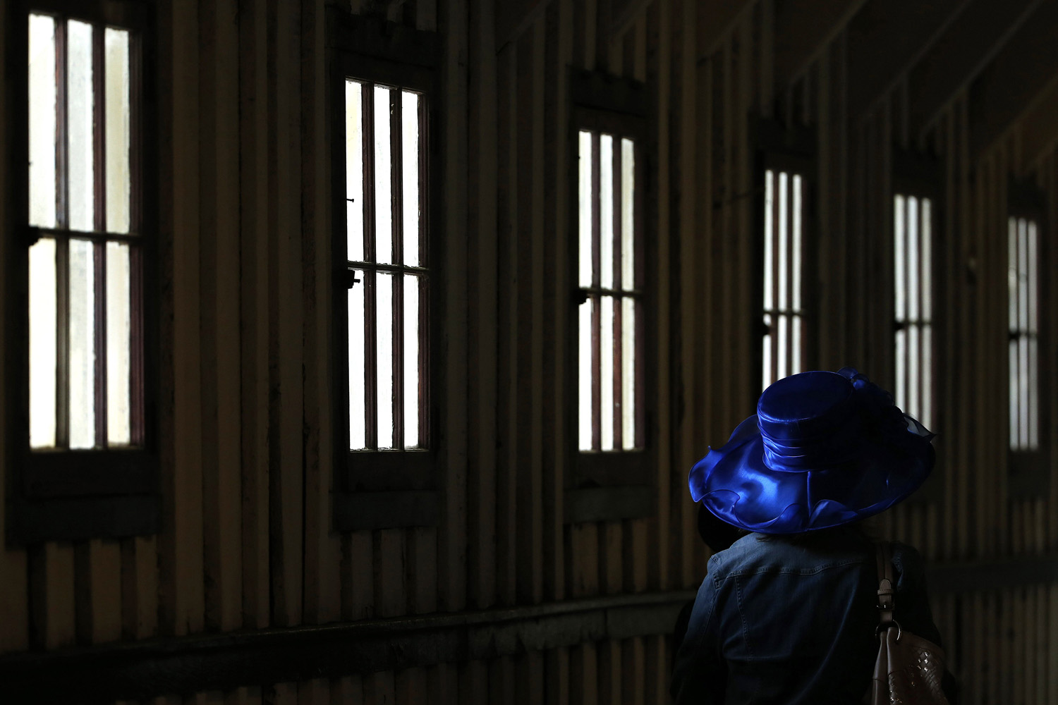 May 17, 2014. A racing fan heads to the track before the 139th Preakness Stakes horse race at Pimlico Race Course in Baltimore.
