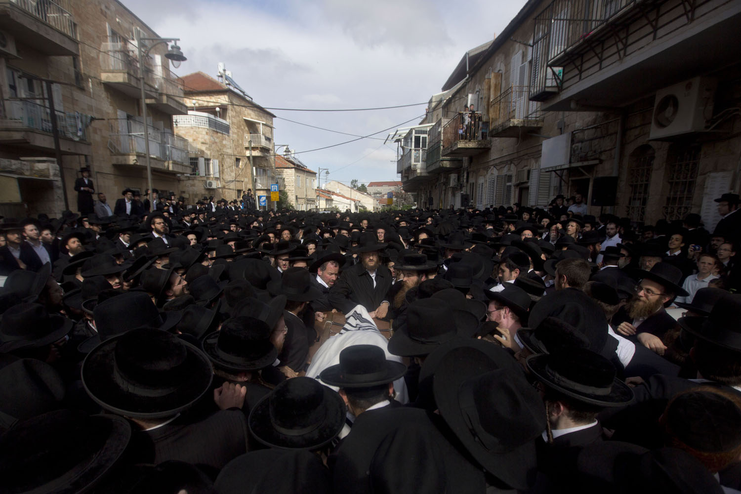 May 8, 2014. Ultra-Orthodox Jewish men carry the body of Rabbi Zundel Kroizer during his funeral in Jerusalem.