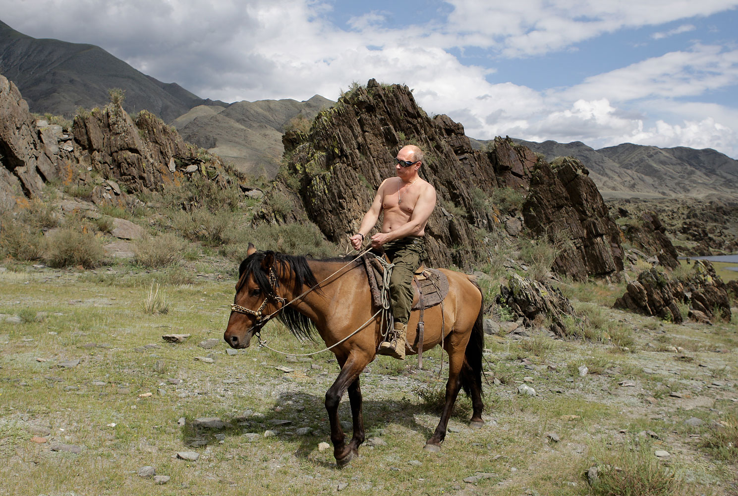 Russian commentators noted that the photographs evoked associations with the mythic heroes of Russia, like the many horsemen who once rode the Russian steppe, defending it from foreign invaders, Aug. 3, 2009.