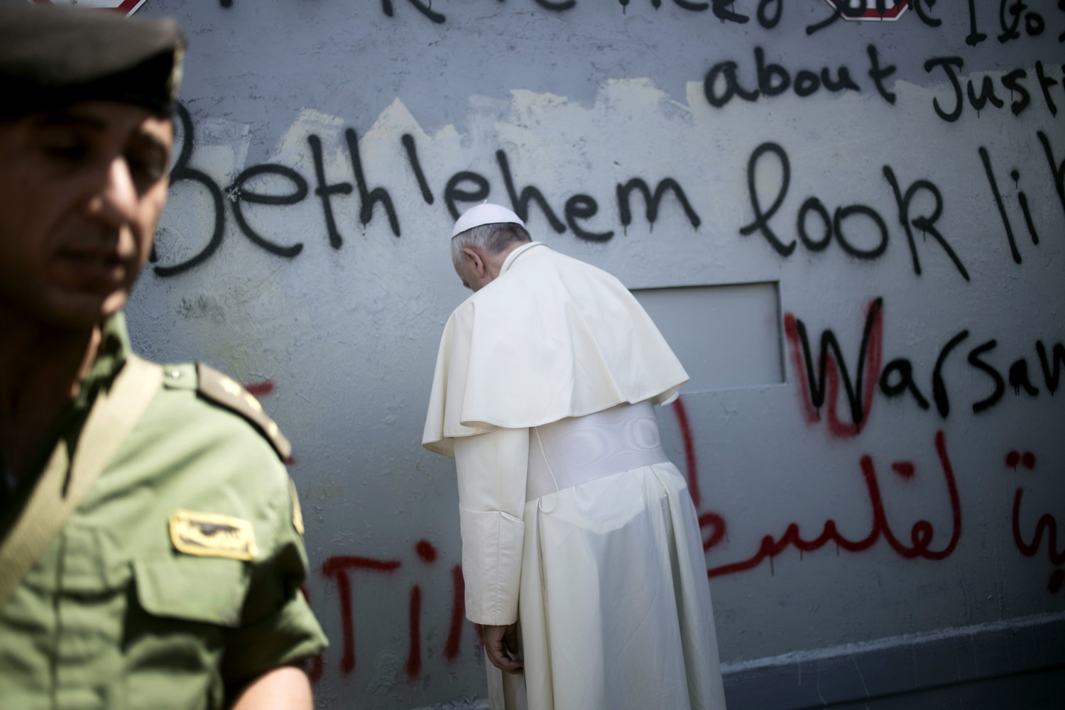 May 25, 2014. Pope Francis prays at Israel's separation barrier on his way to a mass in Manger Square next to the Church of the Nativity in Bethlehem.