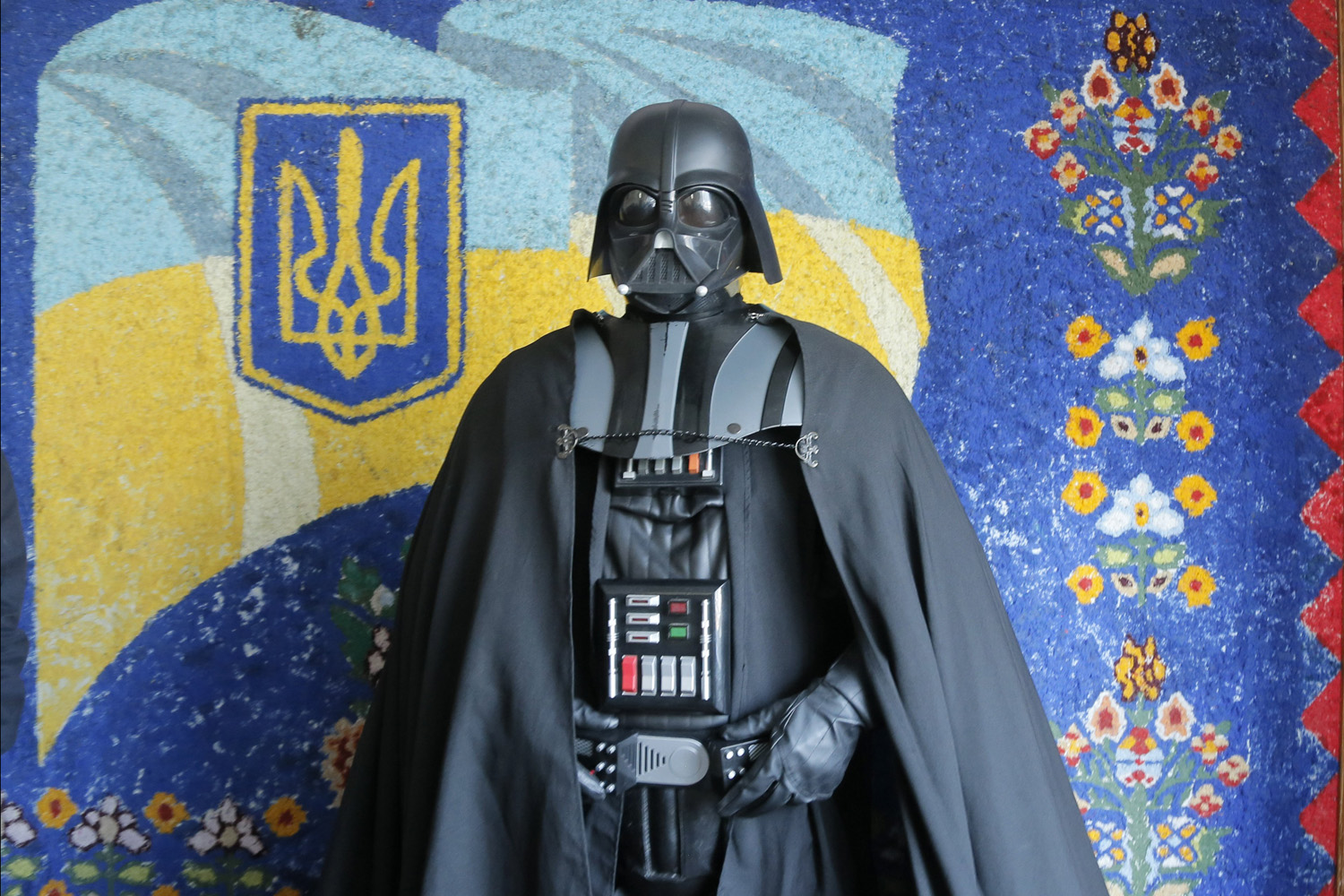 Darth Vader, the Ukrainian Internet Party mayoral candidate for Kiev and Odessa, speaks to the press in front of a painting of the Ukrainian flag at a polling station during the presidential and mayoral elections in Kiev, Ukraine on May, 25, 2014.
