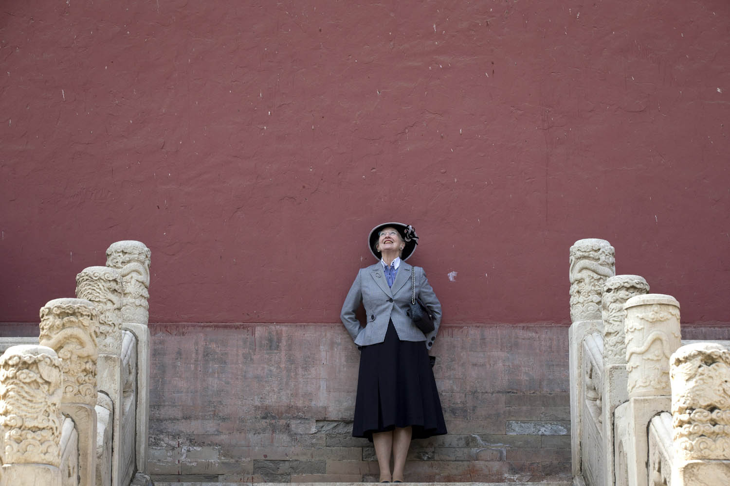 Danish Queen Margrethe II poses for photos as she visits Ming Tombs on the outskirts of Beijing on Saturday, April 26, 2014.
