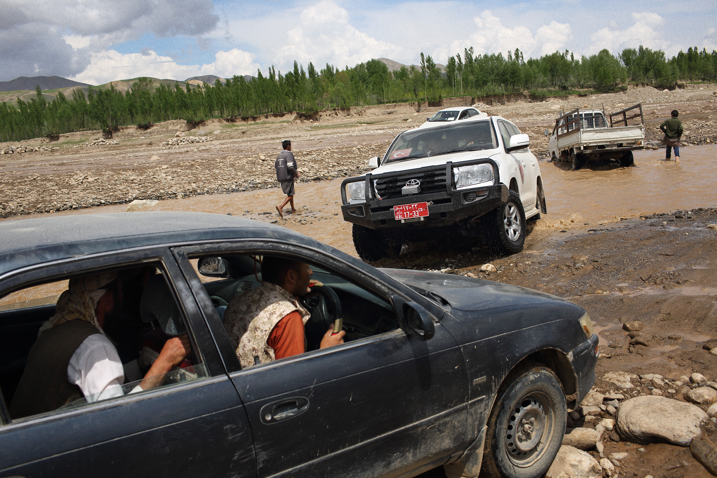 The road from the capital of Badakhshan, Faizabad to Abi Barik, is becoming increasingly hard to pass as trucks filled with aid dig deep ruts in river crossings, further hampering already compromised aid efforts, May 6, 2014.