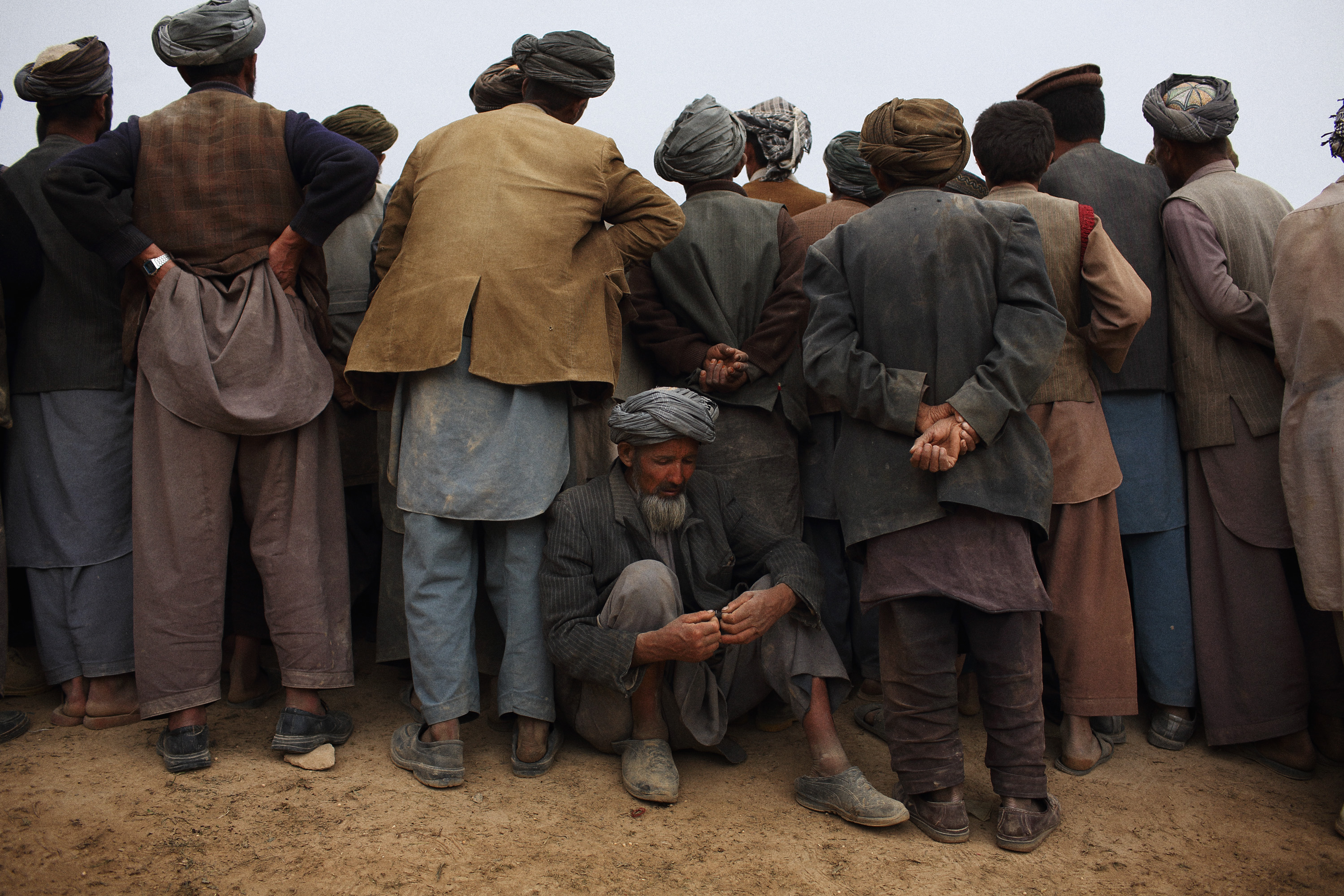 A meeting is held in the center of the village following clashes between police and locals, May 6, 2014.
