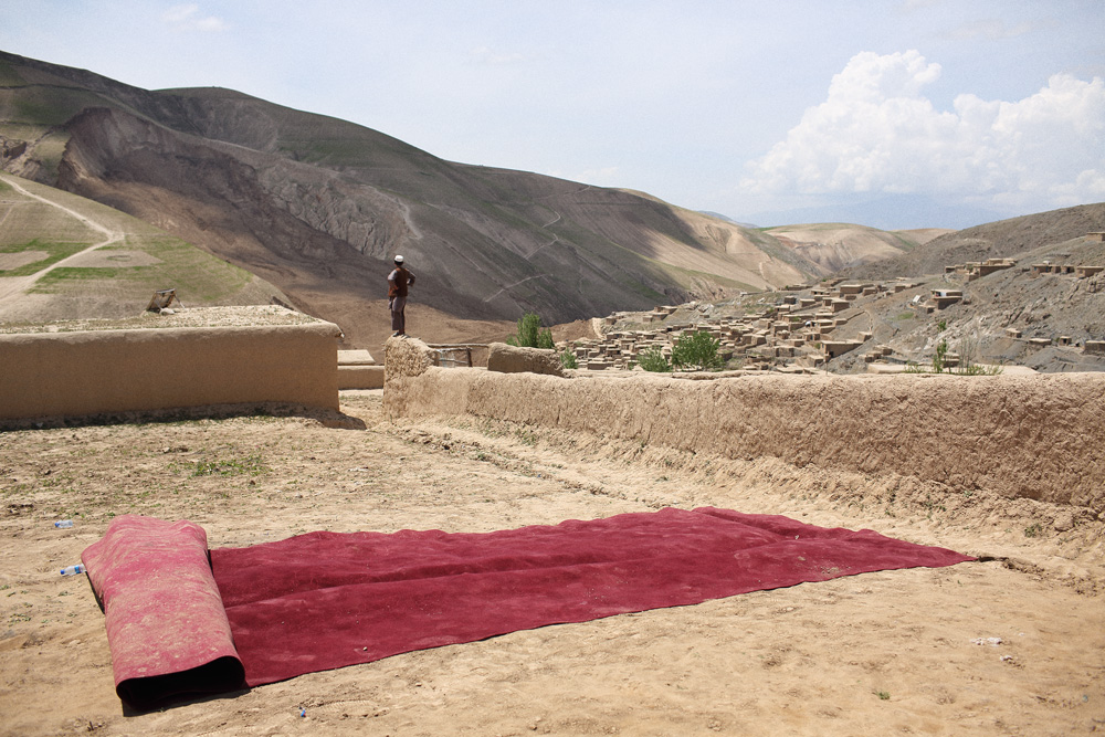 Red carpets were rolled out, then away, after a visit by President Hamid Karzai, May 7, 2014.