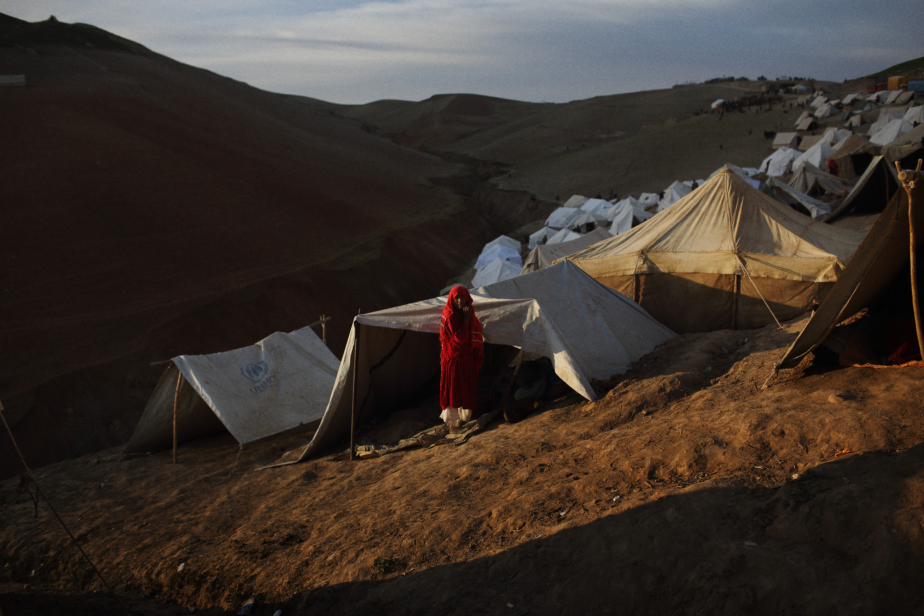 A woman by her tent on the side of a steep hill at the top of Abi Barik, May 6, 2014.