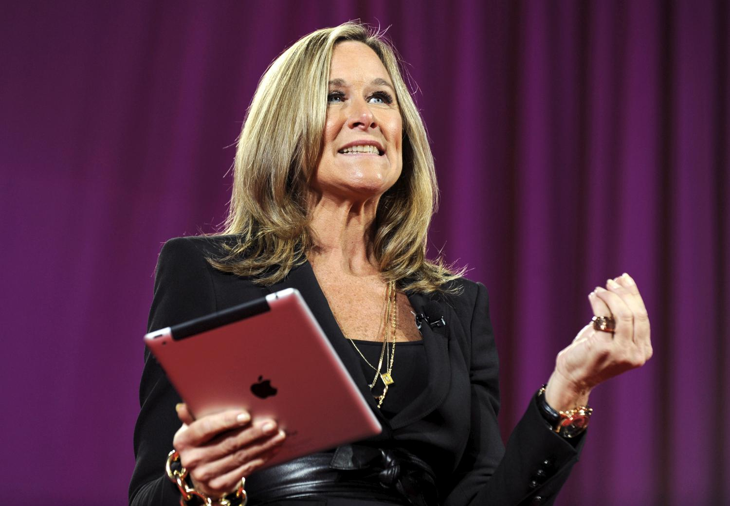 Angela Ahrendts, former Burberry CEO and new Apple retail SVP, seen holding an iPad in 2013