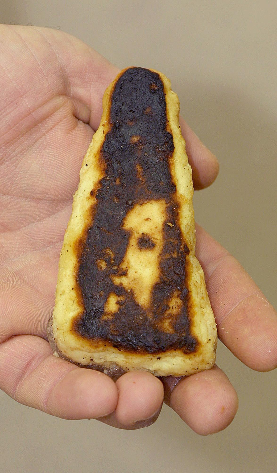 Fred Whan, of Kingston, Ont., shows off a fish stick he cooked that he claims shows the likeness of Jesus Christ.