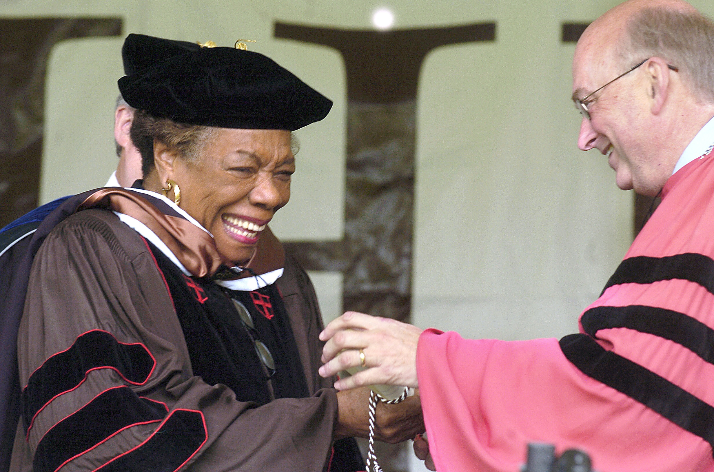 Commencement speaker Angelou smiles after receiving her honorary Doctor of Humane Letters degree, as she greets Lehigh University President Dr. Gregory C. Farrington at Murray H. Goodman Stadium on May 23, 2005. Angelou held a lifetime professorship at Wake Forest and collected honorary degrees from around 50 schools and colleges.