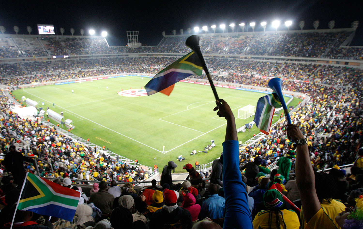Spectators attend an exhibition soccer match between South Africa and Guatemala at the Peter Mokaba Stadium in Polokwane, South Africa, May 31, 2010.