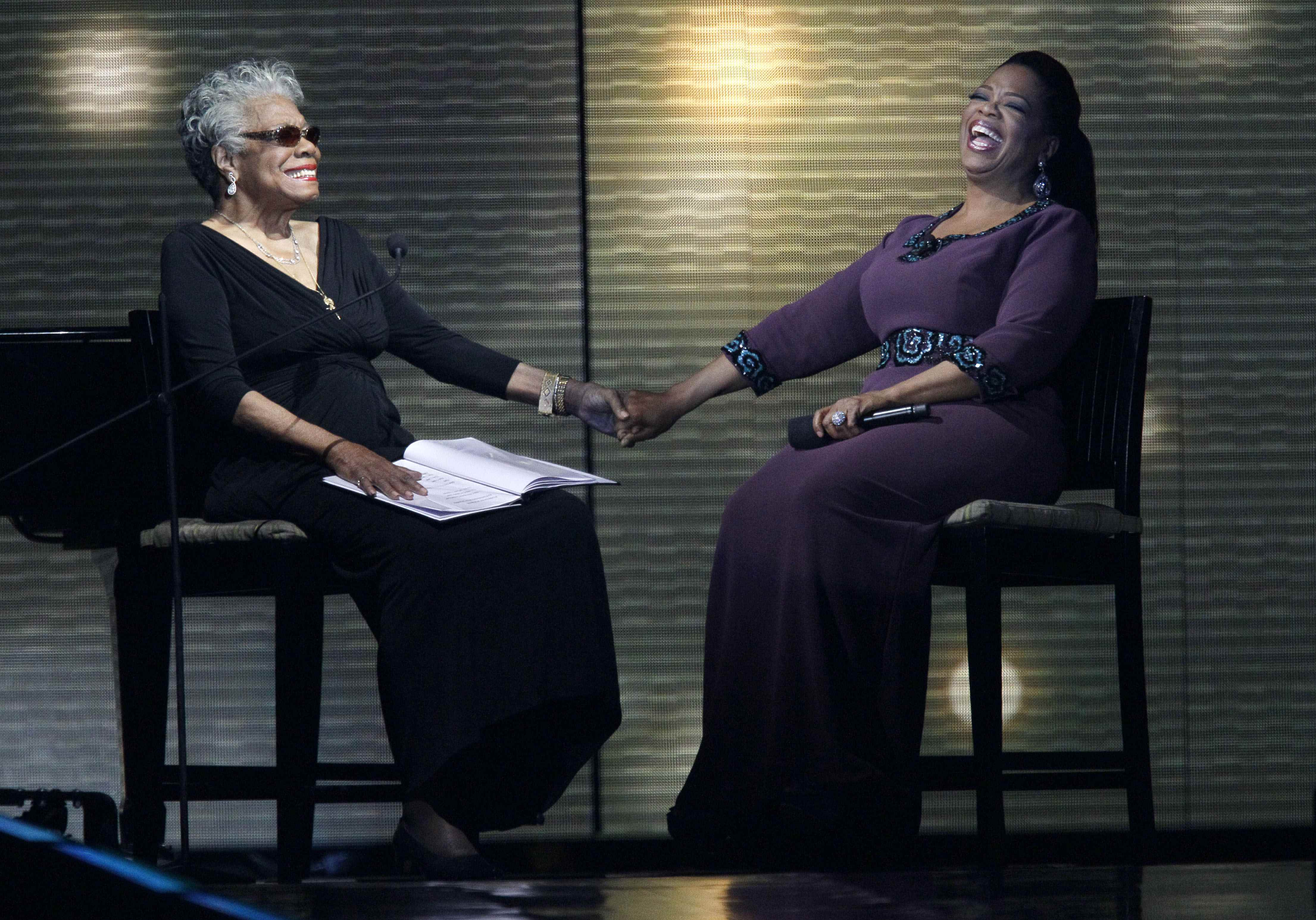 "Angelou and Oprah Winfrey share laughs during the last taping of the ""Oprah Winfrey Show"" on May 17, 2011 in Chicago."