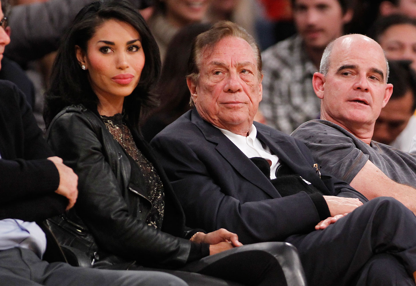 Los Angeles Clippers owner Donald Sterling, center, and V. Stiviano, left, watch the Clippers play the Los Angeles Lakers during an NBA preseason basketball game in Los Angeles, Dec. 19, 2010.