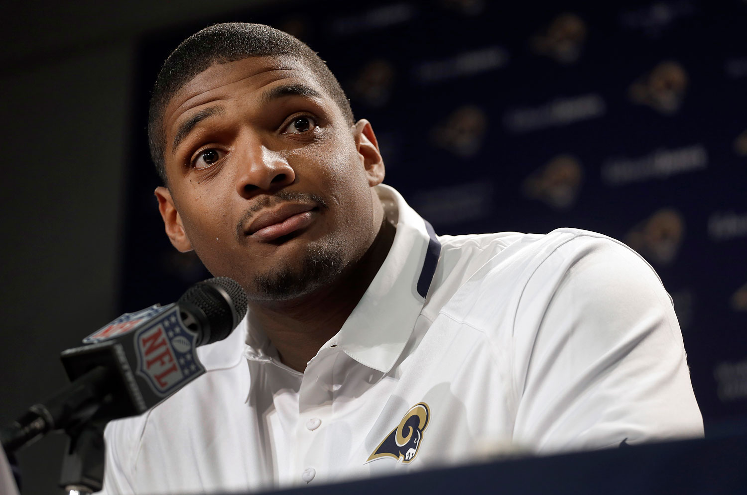 St. Louis Rams seventh-round draft pick Michael Sam listens to a question during a news conference at the NFL football team's practice facility, May 13, 2014, in St. Louis.