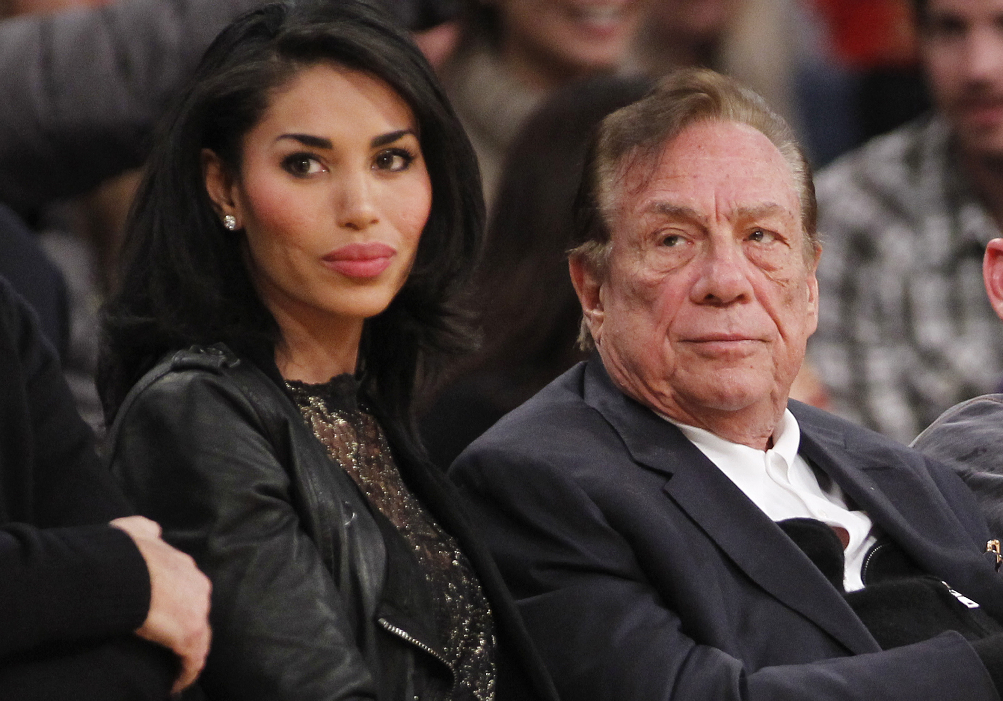Los Angeles Clippers owner Donald Sterling, right, and V. Stiviano, left, watch the Clippers play the Los Angeles Lakers during an NBA preseason basketball game in Los Angeles on Monday, Dec. 19, 2011.