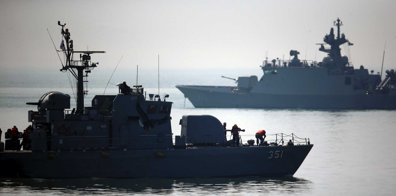 South Korean navy warships patrol around Daecheong island near the West Sea border with North Korea, Tuesday, April 1, 2014.