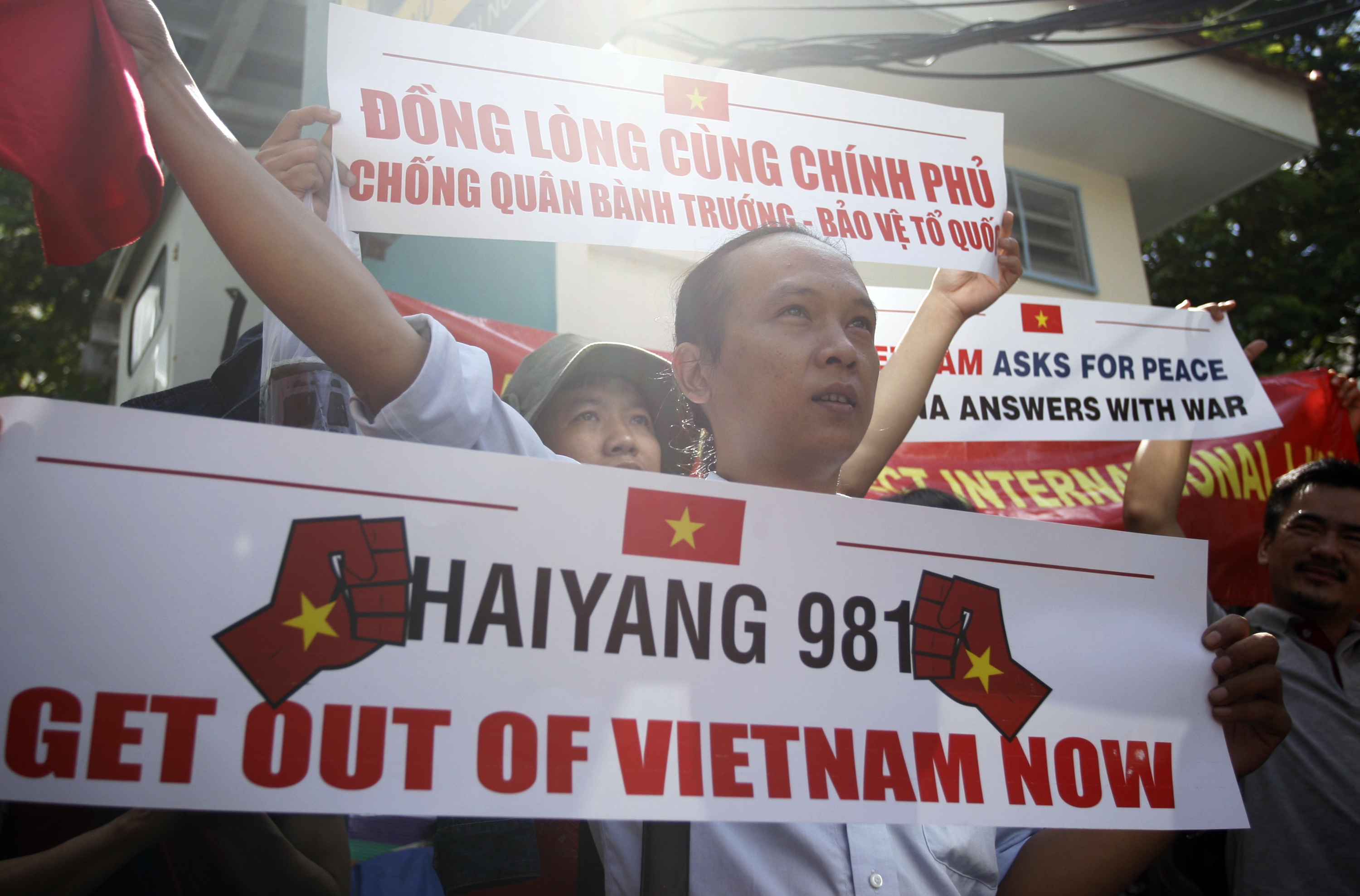 Vietnamese protest against China's deployment of an oil rig in the disputed South China Sea in front of the Chinese Consulate in Ho Chi Minh City on Saturday, May 10, 2014.