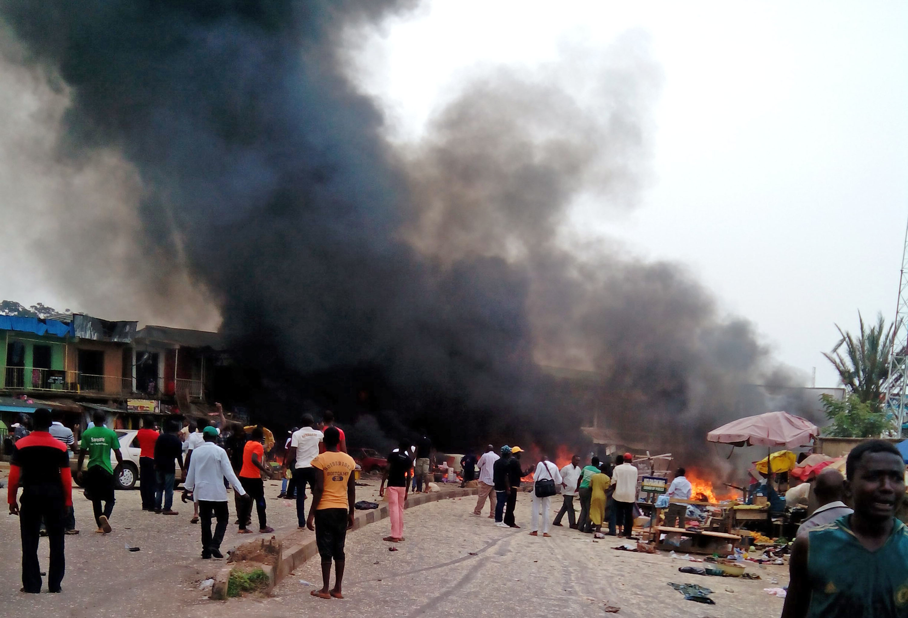 Smoke rises after a bomb blast at a bus terminal in Jos, Nigeria, Tuesday, May 20, 2014.