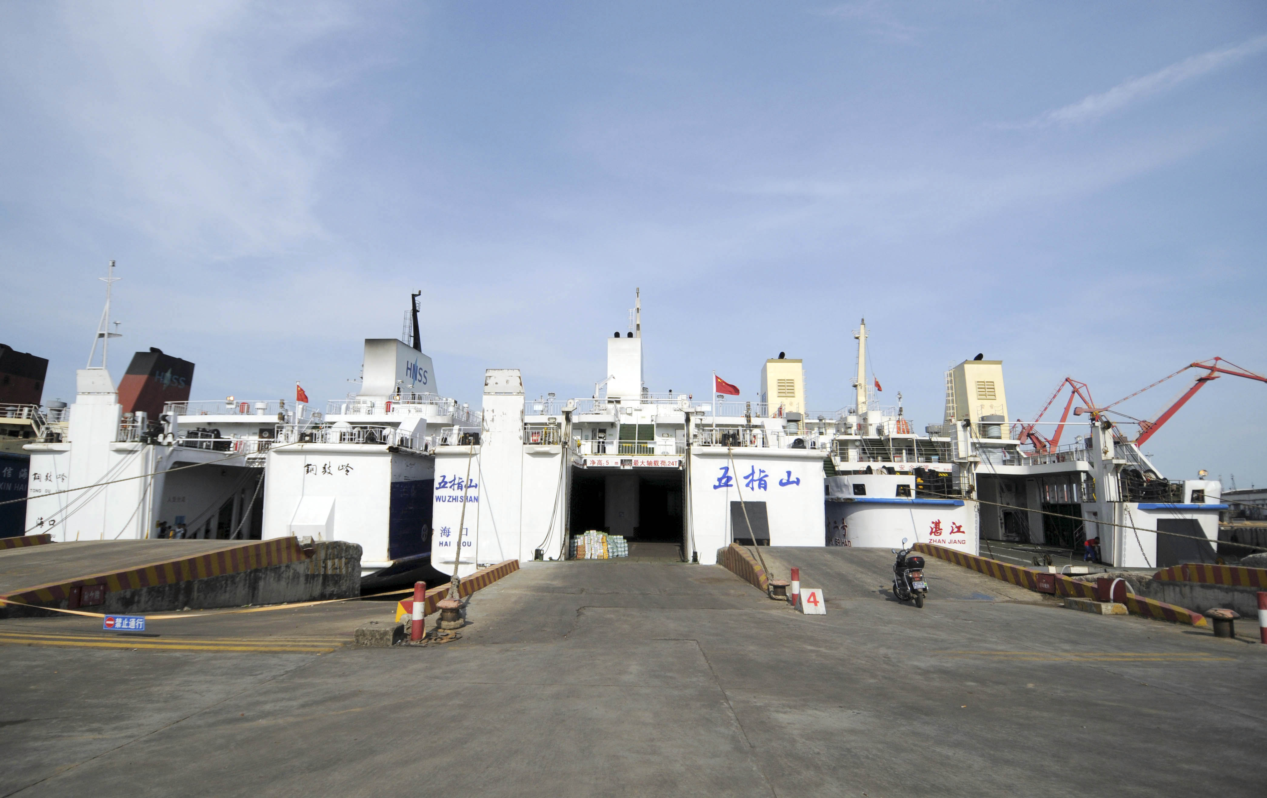 Chinese passenger ships Wuzhishan, center, and Tongguling, left, seen at Haikou, capital of south China's Hainan province, before their departure on May 18, 2014