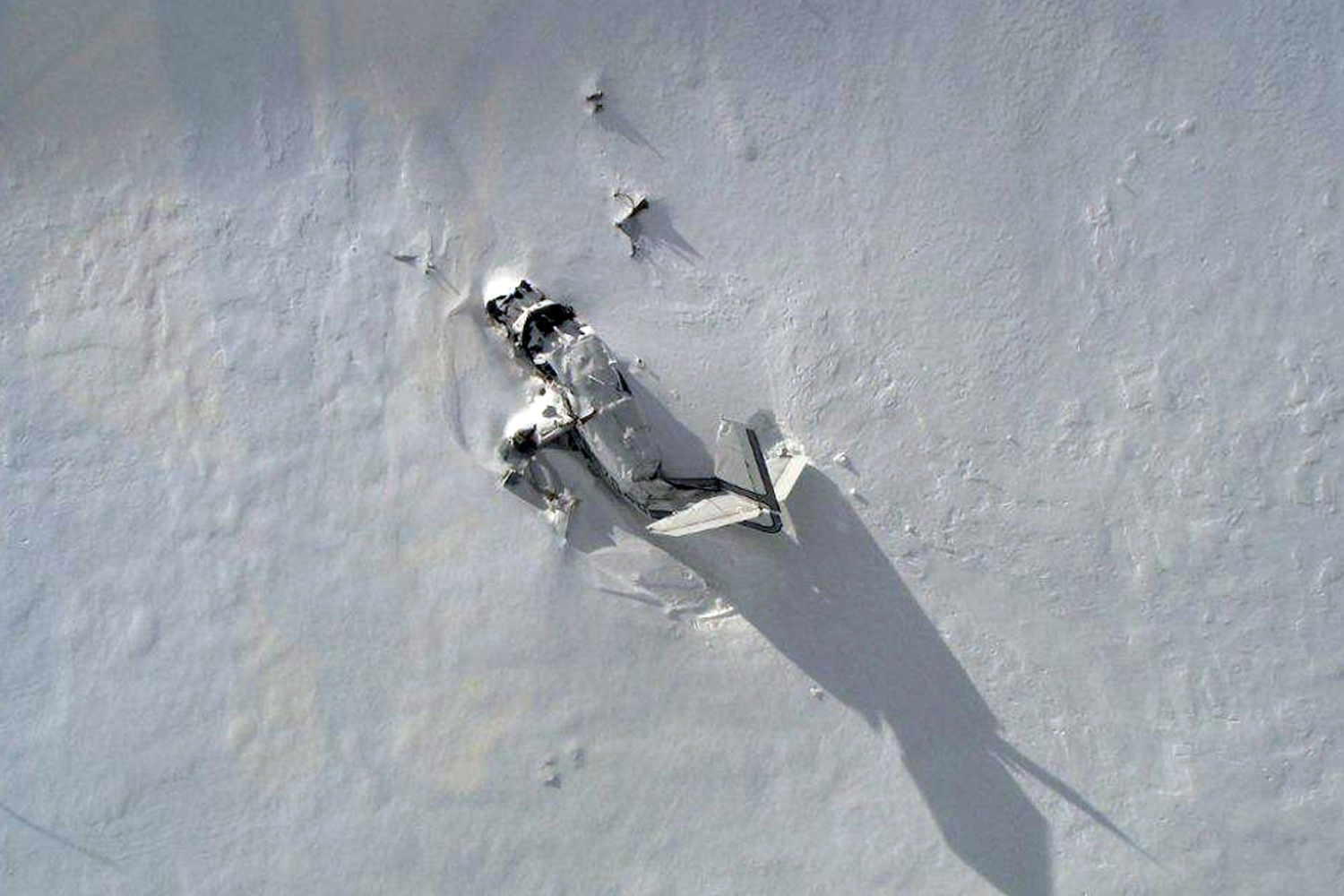 May 12, 2014. This photo provided by the Park County, Wyo., Sheriff's Office shows the wreckage of a single-engine plane on a rugged, snowy mountain outside of Yellowstone National Park Monday.