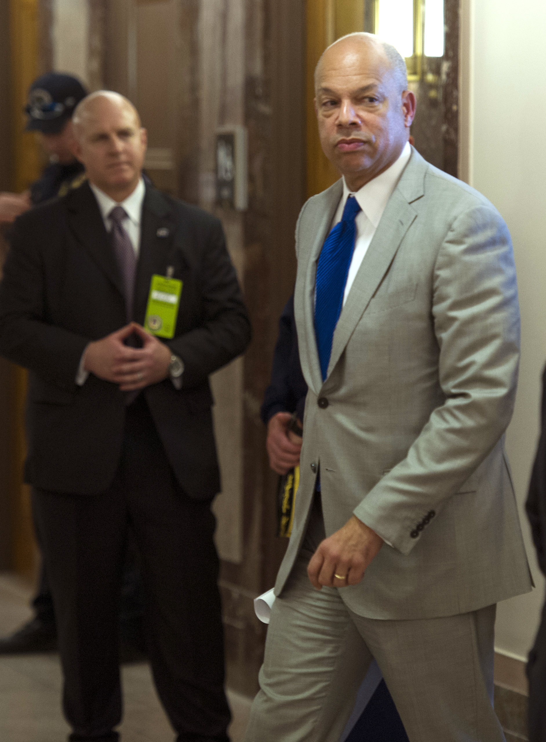 Homeland Security Secretary Jeh Johnson walks to a hearing room to answer questions before a closed meeting of the Senate Homeland Security Committee in Washington, D.C., on April 1, 2014.